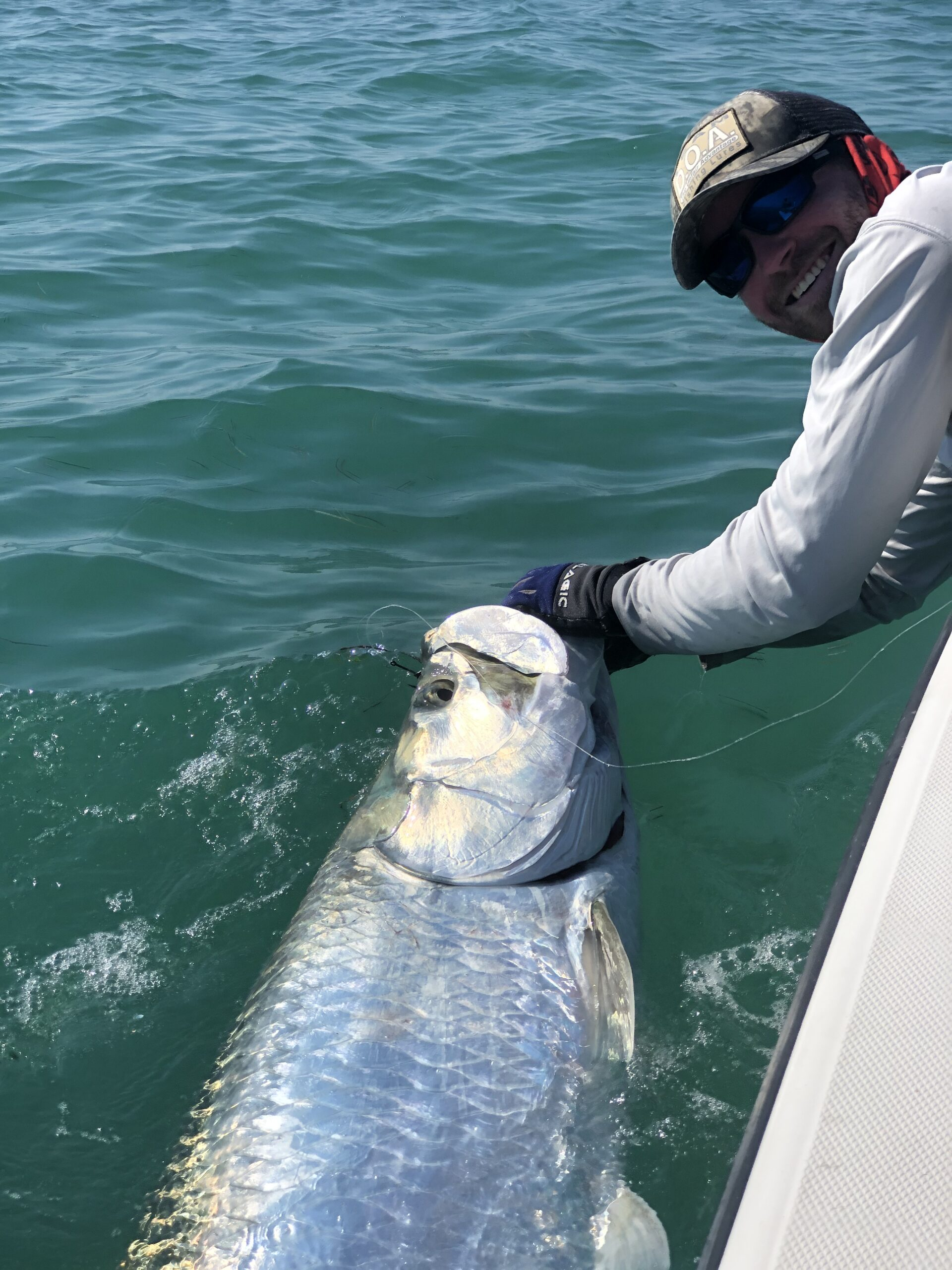 Close up of captain with large Tarpon. Opens a photo gallery.